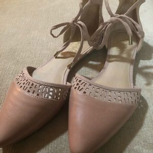 Blush leather flats with tie ankle.